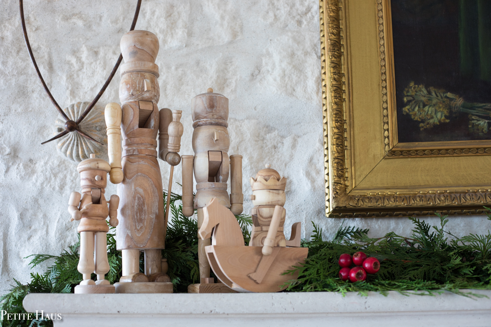 natural wooden nutcrackers on farmhouse Christmas mantel