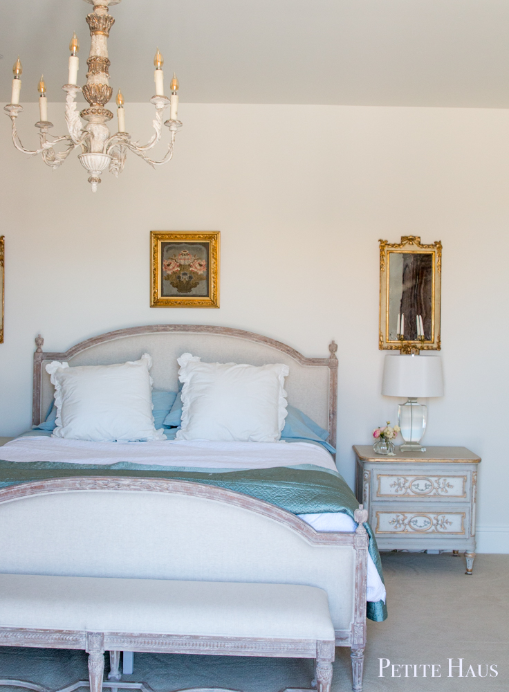 Romantic French country bedroom by Petite House with Eloquence Dauphine bed in weathered white.